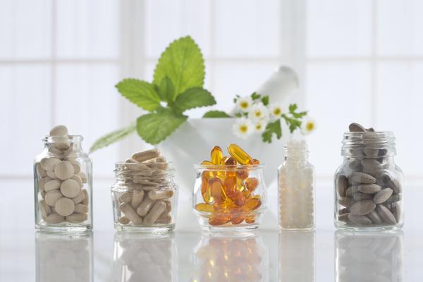 Glass jar of various medicines including Ketotifen.