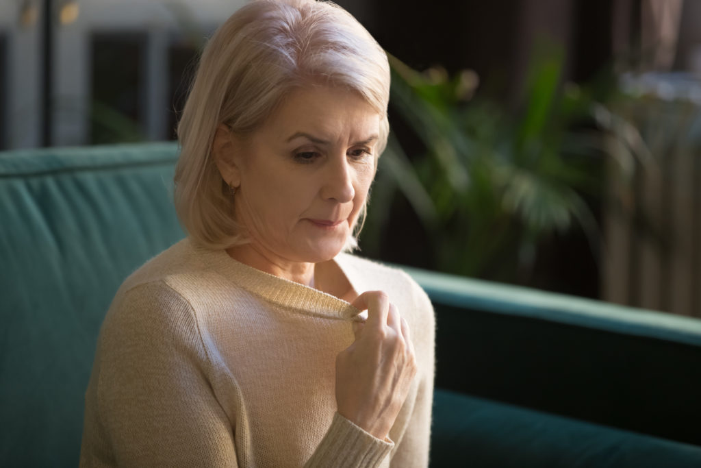 Woman experiencing menopausal symptoms