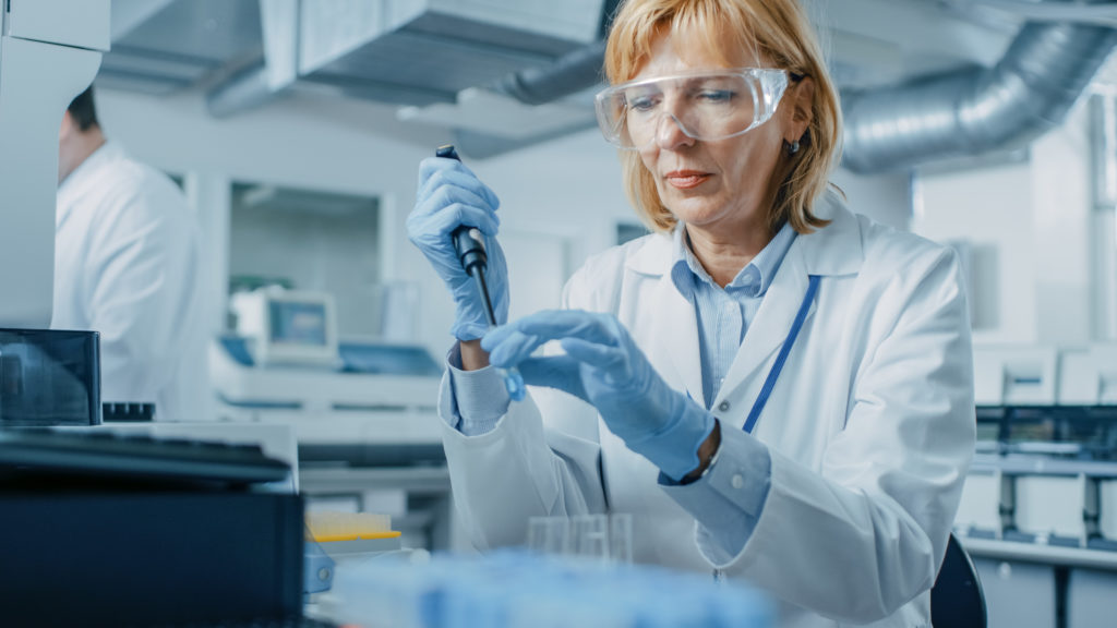 Female Research Scientist working on hormone pellet therapy.